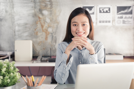 New generation asians business woman using laptop at office,Asian women sitting smiling while working on mobile office concept Stok Fotoğraf - 87332730