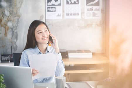 New generation business woman using smartphone,Asian woman are happily working in the office Stock fotó