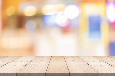 Empty brown wood table top on blur background at shopping mall, copy space for montage you product Stok Fotoğraf