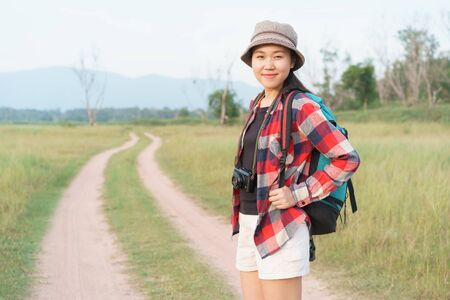 Asian tourist woman. Nature mountain view A young girl is traveling on summer vacation. Stok Fotoğraf