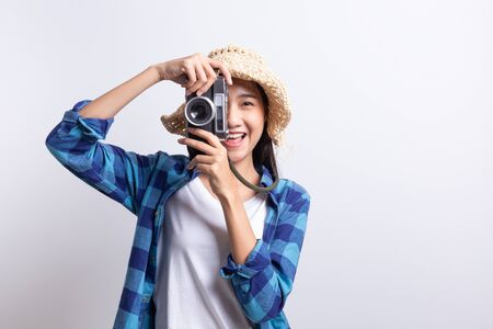 tourist Beautiful of Asian woman holding a film camera  and smiling isolated on white background, Asia girl wear Plaid shirt and wear Straw hat, Summer concept Stok Fotoğraf