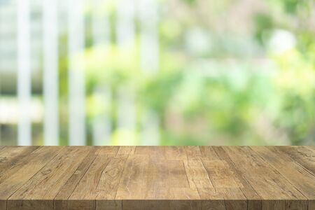 Empty wood table top on blurred background at garden in shopping mall, copy space for montage you product Stok Fotoğraf