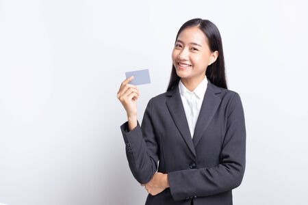 Beautiful of Asian  business women standing holding with blank card and smiling, Copy space,  isolated on white background.  Stok Fotoğraf