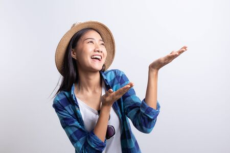 Portrait, tourist Beautiful of Asian woman Present and smiling isolated on white background, Asia girl wear Plaid shirt and wear Straw hat, Sunglasses, copy space, Summer concept Stok Fotoğraf