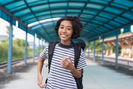 Asian kid girl is walking to school while carrying a backpack, Back to school concept Imagens