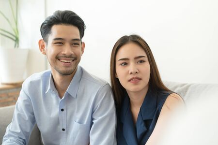 Asian couple sitting on the couch in the psychiatrist room to consult mental health problems by doctor, Health and illness concepts