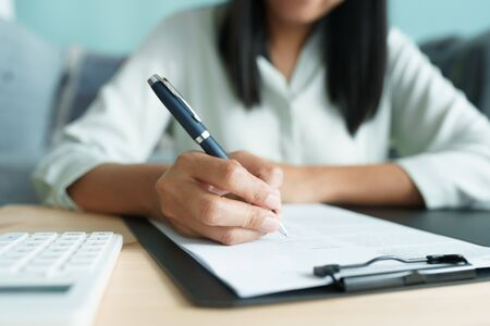 Asian businesswoman is signing agreement with a business contract. Business. Concept and contract signing