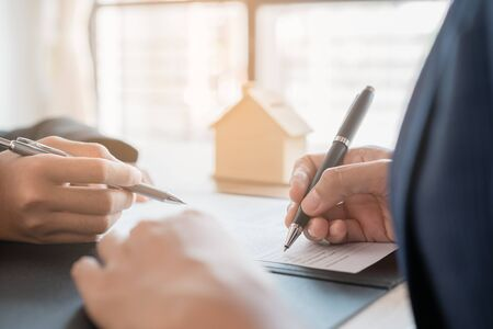 Salesmen are letting the woman customers sign the sales contract, Asian women and female are doing business in the office, Business concept and contract signing