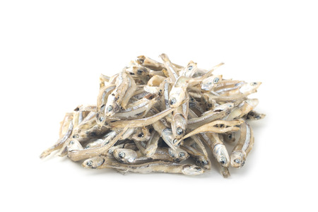 heap of dry anchovy isolated on white background Stock Photo