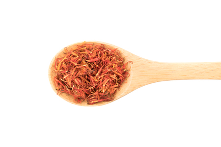 top view dry safflower in wooden spoon isolated on white background