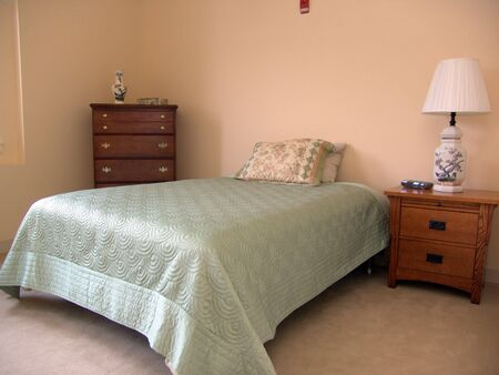 respite: bedroom showing bed, dresser, lamp and more
