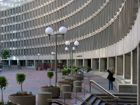 photograph of a woman photographing government center plaza in boston Stock Photo