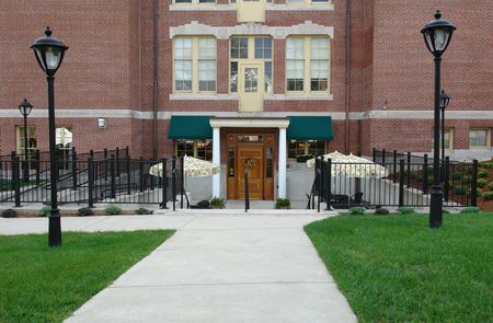 front entry: Shows front entry to apartment building with old fashioned street lights, built in 1904