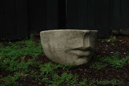 Sculpture of half a face in boston