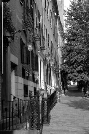 a well lit scene from Beacon Hill showing some of the historic brownsone row houses photo