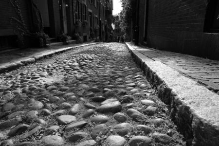 childs eye view of one of the original cobblestone streets in america, Acorn Street in Beacon Hill in Boston