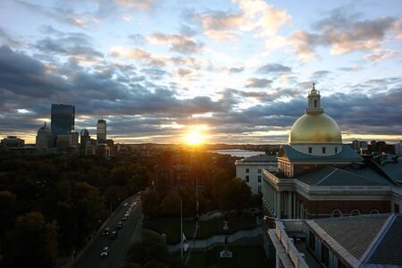 Showing Beacon street and the Massachusetts State Houseat sunset