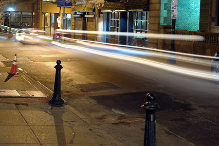swish: cars swish past in the night on beacon street in boston Stock Photo