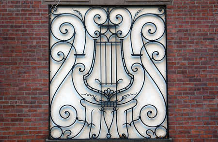 fancy musical design inset in wall surrounded by brick