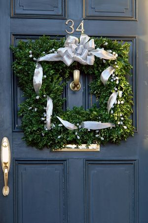 unique square christmas wreath hanging outside on door photo
