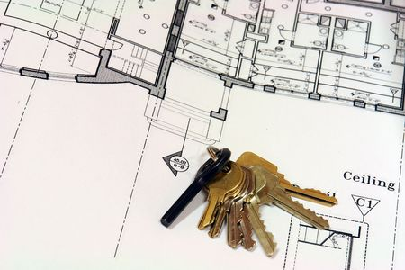 autocad: close up of blue prints with ring of keys