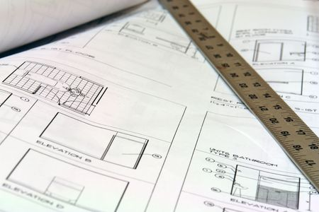 close up of blue prints with metal ruler photo
