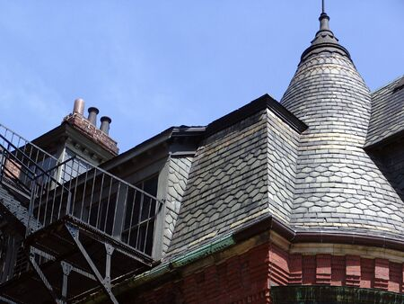 brownstone: detail of the roof and peaks on an old brownstone building in boston massachusetts on newbury street Stock Photo