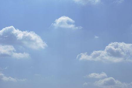 wispy: soft wispy white clouds against a rich royal blue sky Stock Photo