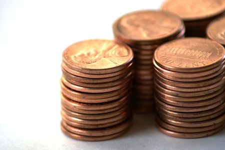 penny pinching: Stacks of  US pennies against a white background Stock Photo
