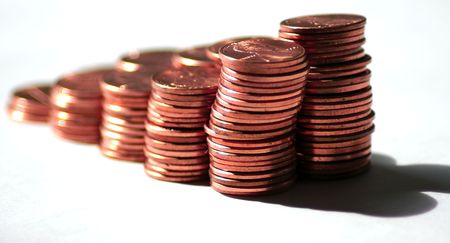 penny pinching: Stacks of US pennies against a white background fading away Stock Photo