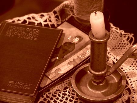 old fashioned: Sepia toned image of old fashioned still life with candlestick, photo, lace doily, and photo       Stock Photo