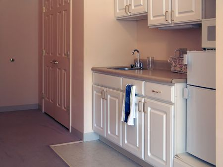 dorm: kitchenette in small apartment in assisted living complex