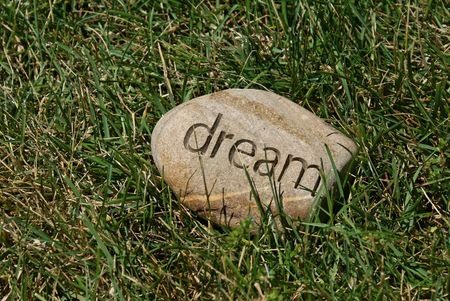 inscribed: field of dreams. a rock with the word dream inscribed in it