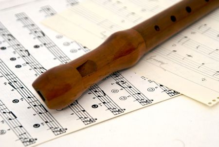 woodwind recorder laying diagonally on sheet music Stock Photo - 1797997