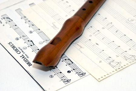 woodwind recorder laying diagonally on hand drawn sheet music Stock Photo - 1797999