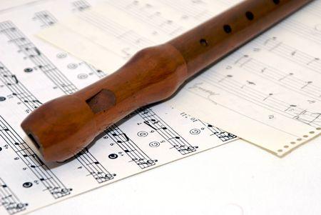 woodwind recorder laying diagonally on sheet music Stock Photo - 1808936