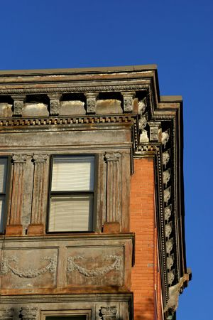 detail of old building in downtown boston, showing carved details and peeling cracked paint