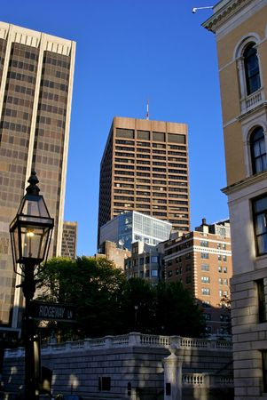 cluster house: late afternoon on Derne Street at the corner of Ridgeway Lane in downtown boston, showing skyscrapers, apartment buildings and the back of the massachusetts state house Stock Photo
