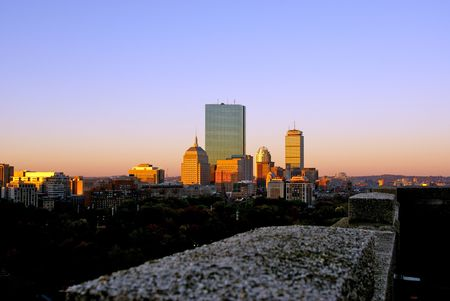 the warm color of the sun bathes the boston skyline on a cool autumn morning Stock Photo - 2042346