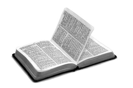 bible open to the book of job chapters 13 through 15 page is in the air as if turning by itself Stock Photo