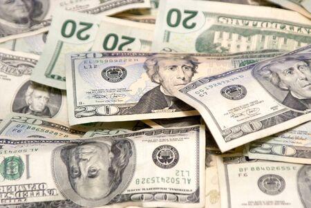 적합: image of scattered united states currency, twenties and hundreds, suitable for a background 스톡 콘텐츠