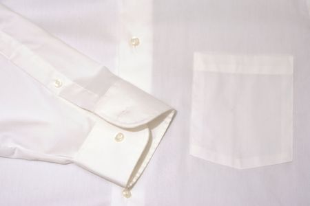 the sleeve: white shirt background or wallpaper with pocket and buttons and sleeve