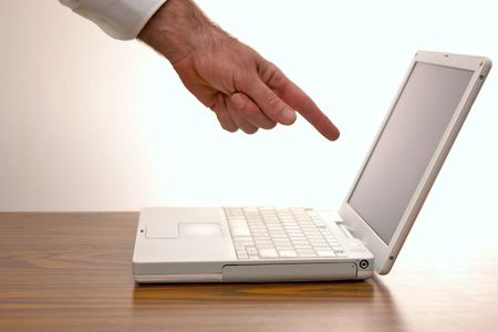lap top: man pointing at an open laptop computer screen  Stock Photo