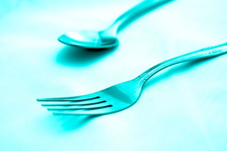beautiful artistic tinted image of fork and spoon