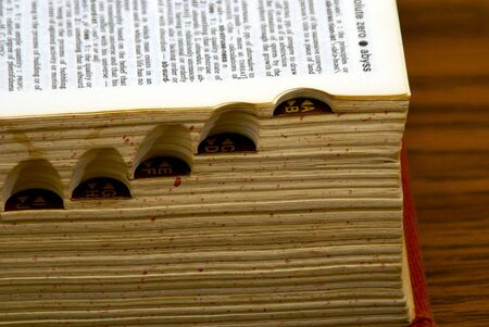 old dictionary with page open, showing side tabs Archivio Fotografico