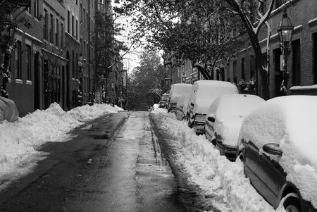 blanketed: street on beacon hill after snow storm in black and white Stock Photo