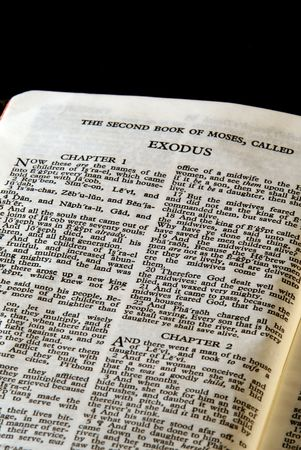 Detail of antique holy bible open to the second book of moses called exodus in the old testament