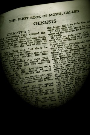 genesis: Detail of antique holy bible open to the first book of moses called genesis in the old testament finished in sepia Stock Photo