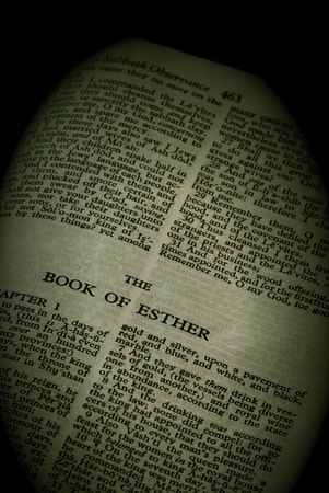 bible series, detail of an old antique holy bible against a black background open to the book of esther old testament finished in sepia Stock Photo