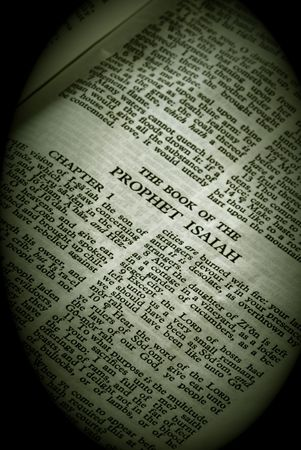 isaiah: Bible Series. close up detail of antique holy bible open to the book of the prophet isaiah in the old testament